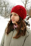 Teenage girl in red cap portrait Stock Image