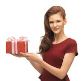 Teenage girl in red dress with gift box Royalty Free Stock Photography