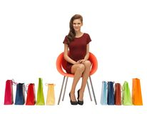 Teenage girl in red dress with shopping bags Stock Photo