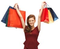 Teenage girl in red dress with shopping bags Royalty Free Stock Image