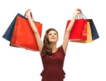 Teenage girl in red dress with shopping bags Stock Image