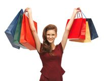Teenage girl in red dress with shopping bags Royalty Free Stock Images