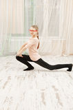 Teenage girl stretching out Stock Image