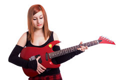Teenage girl with a red guitar Royalty Free Stock Images