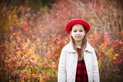Teenage girl in red hat at autumn park Royalty Free Stock Photos