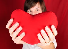 Teenage girl with red heart Stock Images