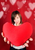 Teenage girl with red heart Royalty Free Stock Photography