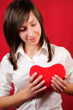 Teenage girl with red heart shape Stock Image