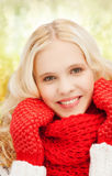 Teenage girl in red mittens and scarf Royalty Free Stock Image