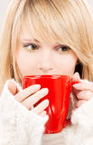 Teenage girl with red mug Royalty Free Stock Image