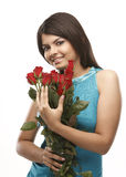 Teenage girl with red roses Stock Images