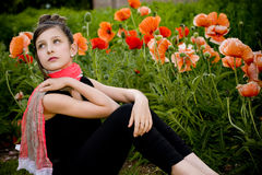 Teenage girl with red scarf and red poppies Royalty Free Stock Photography