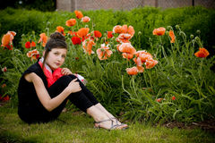 Teenage girl with red scarf and red poppies Royalty Free Stock Images