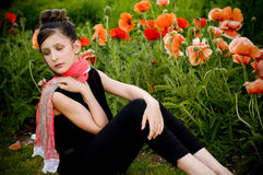 Teenage girl with red scarf and red poppies Royalty Free Stock Photo