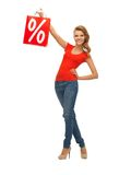 Teenage girl in red t-shirt with shopping bag Stock Image