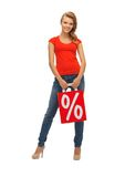 Teenage girl in red t-shirt with shopping bag Royalty Free Stock Images