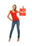 Teenage girl in red t-shirt with shopping bag Stock Photo