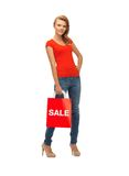 Teenage girl in red t-shirt with shopping bag Stock Photography