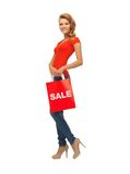 Teenage girl in red t-shirt with shopping bag Royalty Free Stock Photos