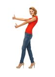 Teenage girl in red t-shirt showing thumbs up Royalty Free Stock Image