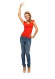 Teenage girl in red t-shirt showing victory sign Stock Photo
