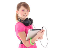 Teenage girl in red with tablet pc Stock Photos