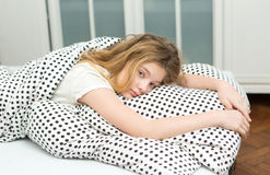 Teenage girl relax in bed Royalty Free Stock Photography