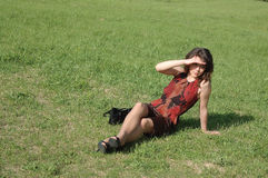Teenage girl relaxing on field Royalty Free Stock Photos