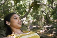 Teenage Girl Relaxing In Forest Royalty Free Stock Image