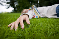 Teenage girl relaxing in grass Stock Images