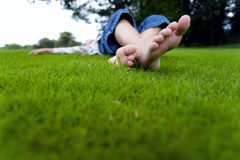 Teenage girl relaxing in grass Royalty Free Stock Image