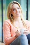 Teenage Girl Relaxing At Home With Hot Drink Royalty Free Stock Photography