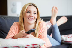 Teenage Girl Relaxing At Home Watching Television Stock Images