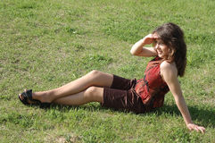 Teenage Girl Relaxing On Grass Royalty Free Stock Photo