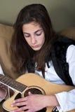 Teenage girl playing the guitar Stock Photos