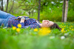 teenage girl relaxing in spring park Stock Photos