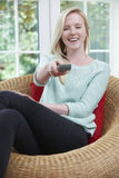 Teenage Girl Relaxing And Watching TV At Home stock image