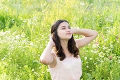 Teenage girl resting on flower meadow Royalty Free Stock Image