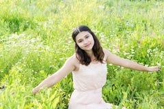 Teenage girl resting on flower meadow Stock Photo