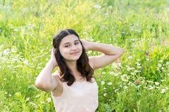 Teenage girl resting on flower meadow Royalty Free Stock Photo
