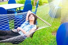 Teenage girl resting in hammock at resort, eyes closed Royalty Free Stock Photos