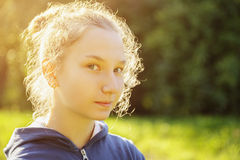 Teenage girl restrained smile in front of camera Royalty Free Stock Photography