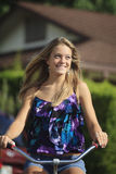 Teenage girl rides her bicycle Royalty Free Stock Image
