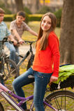 Teenage girl riding bicycles with her friends Royalty Free Stock Images