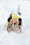 Teenage Girl Riding On Sledge In Snowy Landscape Royalty Free Stock Photography