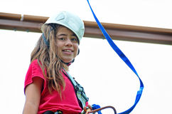 Teenage girl on the roap course sky trail Stock Image