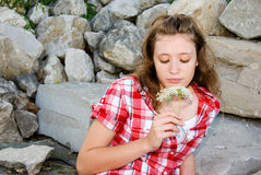 Teenage girl on the rocks Stock Image