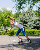 Teenage girl roller blading in a skate park Royalty Free Stock Images
