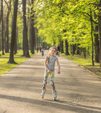 Teenage girl roller skating in colorful leggings Royalty Free Stock Photography