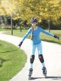 Teenage girl rollerskating in park Royalty Free Stock Photo